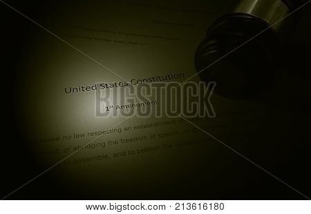 US Constitution text showing the first amendment with legal gavel