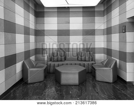 Rest area in modern and luxury hotel hall black and white tone