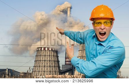 Pollution of invironment. Wicked angry worker factory engineer in a helmet above a head swears and scream at someone and shows on smoky factory pipes. Environmental inspector.