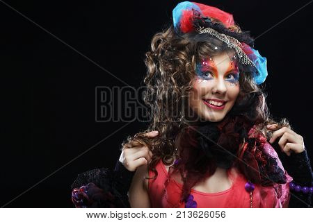 Fashion shot of young woman in doll style. Creative make-up. Fantasy dress.