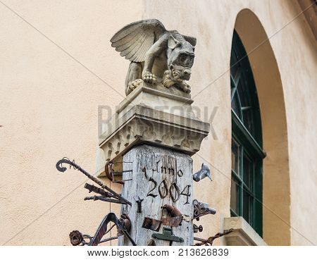 Sibiu Romania October 07 2017 : The top of the pillar next to the smithy decorated with gargoyles and studded with various forging items in Sibiu city in Romania