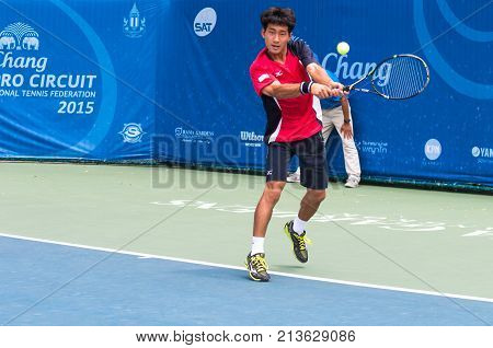 BANGKOK June 24 : Kazuma Kawachi of Japan action in Chang ITF Pro Circuit International Tennis Federation 2015 at Rama Gardens Hotel on June 24 2015 in Bangkok Thailand.