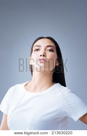 Arrogant woman. Strict smart stubborn woman looking arrogant while throwing her head back and looking into the distance