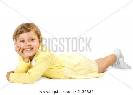 Little girl lias upon floor. Isolate on white background. poster