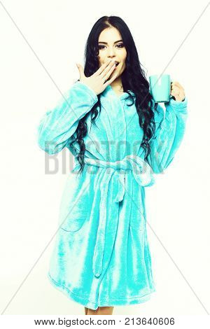 Sexy Surprised Girl Posing In Turquoise Velour Bathrobe With Cup
