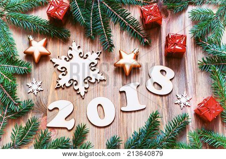 Happy New Year 2018 background with 2018 figures Christmas toys green fir tree branches - New Year 2018 still life in retro tones. Festive New Year 2018 background