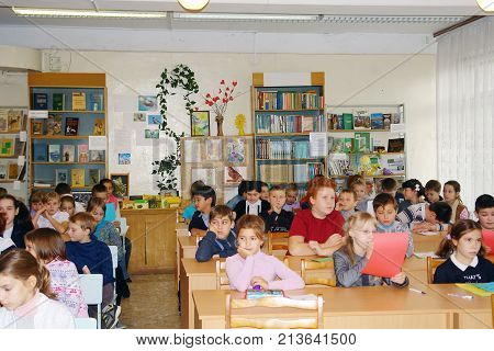 Pupils Sit In Class At Their Desks