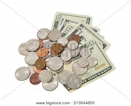 Horizontal shot of folded and fanned out five and twenty dollar bills with a pile of coins on top of them on a white background.