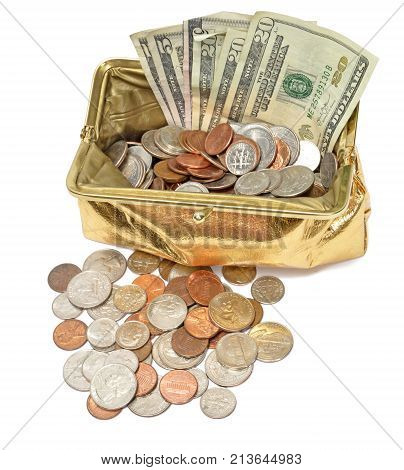 Vertical overhead shot of an open gold metallic coin purse filled with fanned out five and twenty dollar bills and coins on a white background.  There is a pile of coins in front of the purse as well.