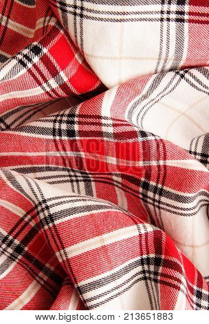 tablecloth fabric red white black colors. selective focus