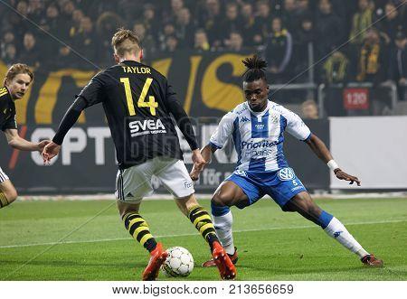 SOLNA SWEDEN - OCT 30 2017: Soccer player Robert Taylor (AIK) dribble to pass Sam Adekube (IFK Goteborg). October 30 2017SolnaSweden
