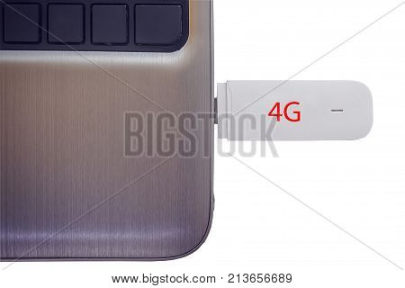 4G modem connected in modern notebook closeup isolated on white background