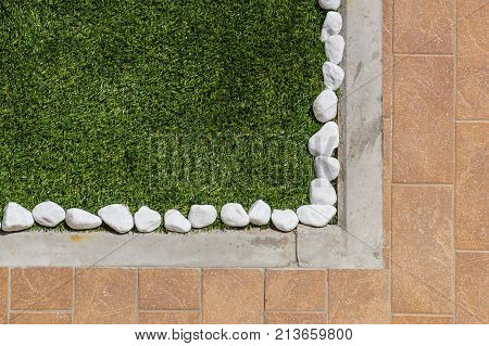 Floor design with terrace tiles and ornamental gravel Various materials for flooring in the garden . Professional gardening .