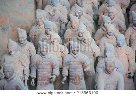 XIAN, CHINA - October 8, 2017: Famous Terracotta Army in Xi'an, China. Mausoleum of Qin Shi Huang, first Emperor of China contains collection of terracotta sculptures depicting armored men and horses.