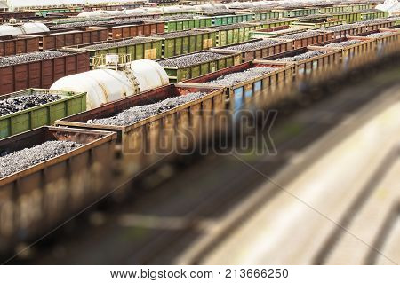 rail cars loaded with coal, a train transports coal. Many different rail cars