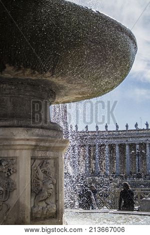 Fountain in St.Peter square with the Bernini's colonnade in the background. Rome Italy