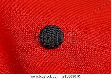 big black button on red cloth of clothes