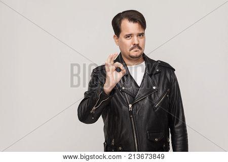 Rocker Man Showing Okay Sign And Looking At Camera.