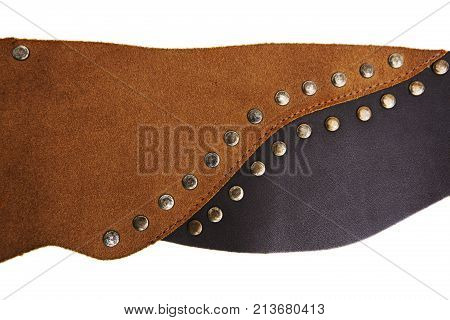 A close-up of the plaques is made of natural brown leather in one row. Model of leather belts