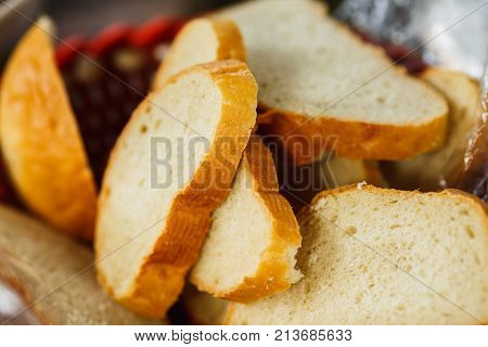 group of bread slices loaf baton closeup