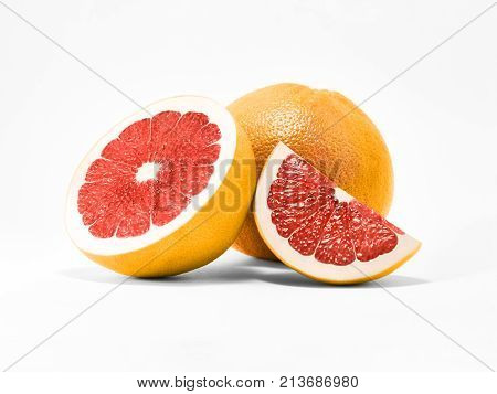 Whole orange grapefruit with half and slice of ripe grapefruit are lying on a white background Close-up fruit photo