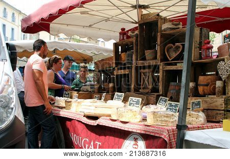 Pezenas, Herault, France - Aug 26 2017: Customers At A Traditional Rustic Old Nougat Stall At A Stre