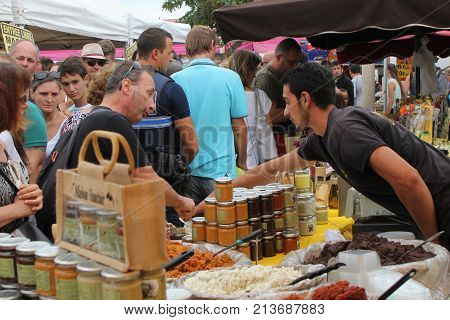 Valras-plage, Herault, France - Aug 25 2017: French Market Trader Selling Jars Of