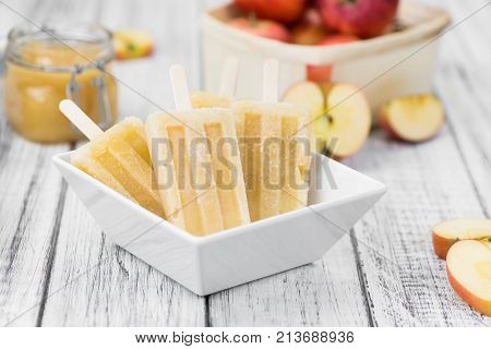 Apple Popsicles On An Old Wooden Table