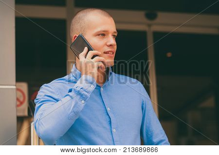 Happy Handsome Man Using Mobile Phone