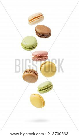 Colorful and falling French Macarons isolated on white background