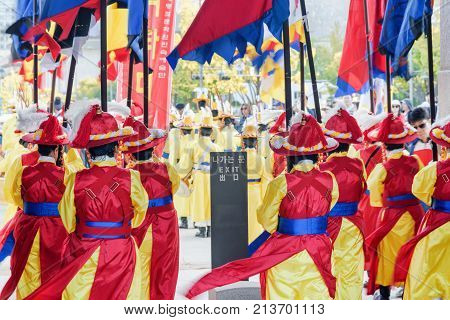 Women Wearing Korean Traditional Dress And Holding Flags, Seoul