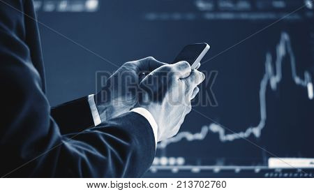 Businessman using mobile smart phone, raising graph background. Business growth, investment and invest in stock exchange market. Online stock market