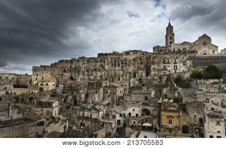Panoramic view of the ancient town of Matera (Sassi di Matera) European Capital of Culture 2019 in beautiful golden morning light with blue sky and clouds Basilicata southern Italy