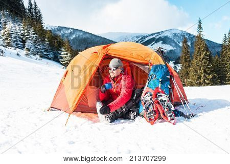 A Man Near A Tent In The Winter.
