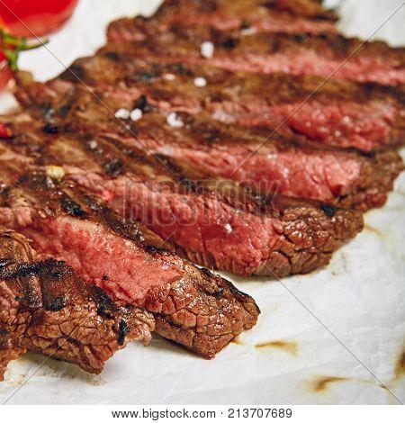 Gourmet Grill Restaurant Beef Steak Menu - Flank Steak on Wooden Background. Beef Steak Dinner