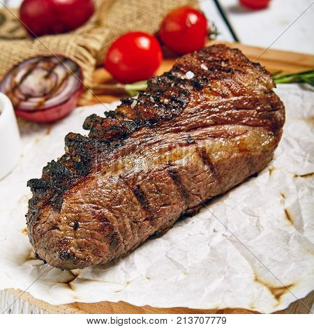 Gourmet Grill Restaurant Steak Menu - Tri-Tip Beef Steak on Wooden Background. Black Angus Prime Beef Steak. Beef Steak Dinner. Top VIew