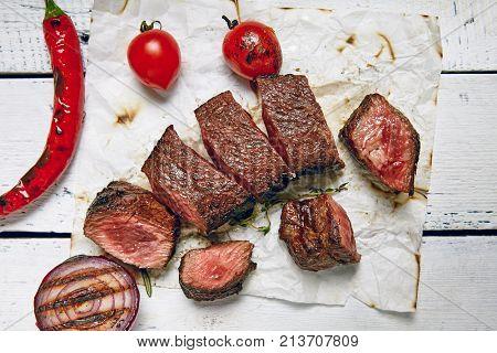 Gourmet Grill Restaurant Beef Steak Menu - Denver Cut Steak on Wooden Background. Black Angus Beef Steak. Beef Steak Dinner