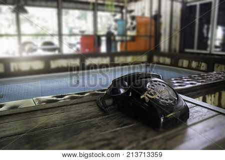 Vintage retro style telephone on wooden table stock photo