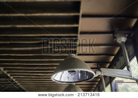 Industrial light lamp with grunge rusty ceiling stock photo