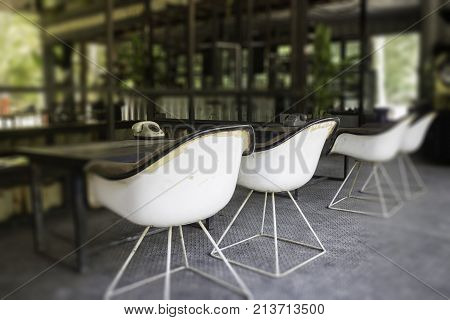 Old arm chairs and wooden table interior stock photo