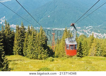 A View To Bright Red Cableway Cabin Moving To The Top Of The Mountain Over The Beautiful Landscapes