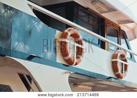 Ship Details, Two Orange Lifebuoys Life Savers Rings Hanging Attached At The Upper Deck Of A Cruise