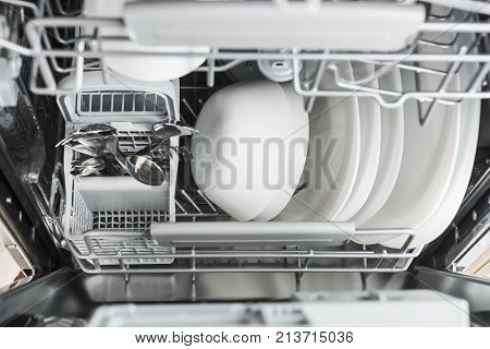 clean dishes in the dishwasher. Kitchen appliances