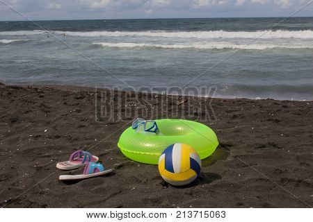 Ball and yellow Floating Ring on beach. Travel or sea vacations concept. Beach life