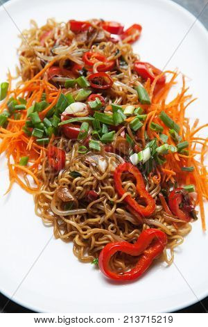 Asian instant noodles with bean sprouts, spring onion, carrot and peppers