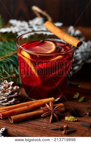 Christmas Mulled Wine With Spices In Cup On Dark Background. Hot Mulled Wine, With Lemon, Anise, Cin