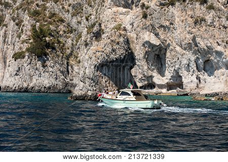 CAPRI ITALY - JUNE 13 2017: Boats with tourists near Grotta Bianca and Grotta Meravigliosa Capri Italy