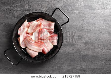 Dish with rashers of bacon on table