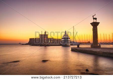 Agios Nikolaos fortress on the Mandraki harbour of Rhodes Greece at dusk