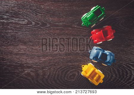 Four cars model on wooden background with copyspace. concept of car rental, auto car insurance and travelling